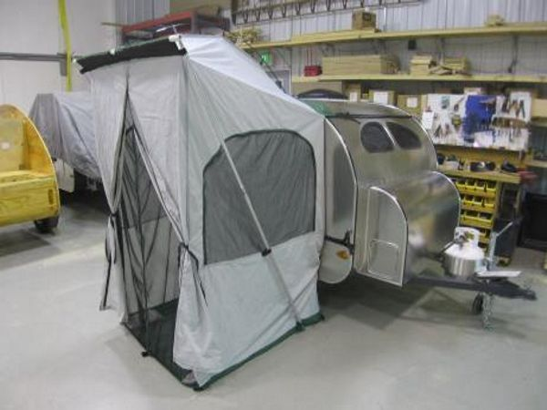 The windows have flaps that can be zipped up for privacy or to keep out the rain and wind. & Camp-Inn Side Tent
